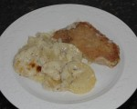 Potatoes and Pork Chops with White Sauce